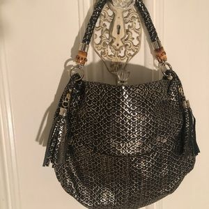 Black and gold couture leather handbag